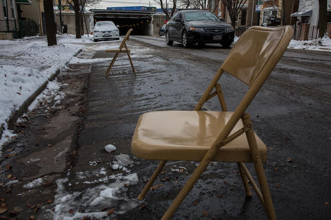 Dibs are in place at 24th Place and Princeton Avenue in the Chicago's Chinatown neighborhood before a storm.