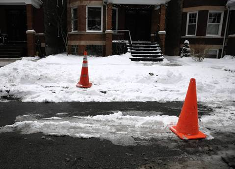 "People use caution cones to hold a parking space in the Chicago tradition of ""dibs,"" on the North Side."