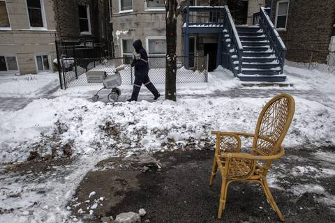 A wicker chair saves a parking spot on Walton Street at Washtenaw Avenue. Claiming dibs for a spot one clears of snow is a Chicago tradition.