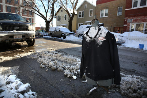 "The streets just east of South California Avenue, between West 26th and West 22nd streets, have almost every spot ""dibbed"" on Feb. 5, 2015, including one with a store model sporting a jersey."