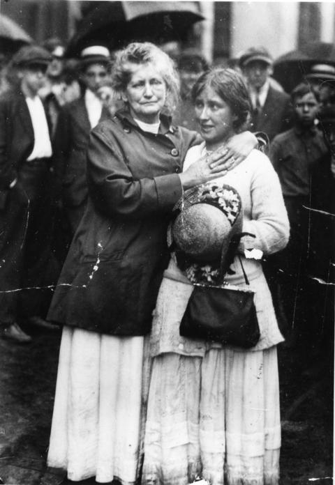 Two women react to the sinking of the SS Eastland on the Chicago River on July 24, 1915.
