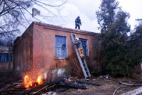 Firefighters try to save a clinic after shelling in the eastern Ukrainian city of Artemivsk on Saturday.