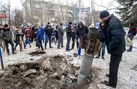 An unexploded missile is embedded in a street in the eastern Ukrainian city of Kramatorsk on Feb. 10.