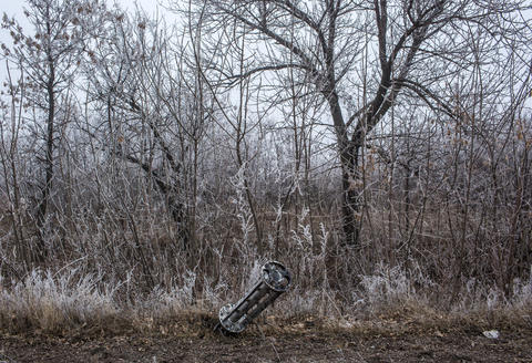 The remnants of a rocket lie on the ground Feb. 15, 2015, along the road to the embattled town of Debaltseve in Luganskoye, Ukraine.