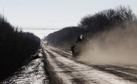 A Ukrainian armored vehicle travels toward Debaltseve, Ukraine, on Feb. 17, 2015.