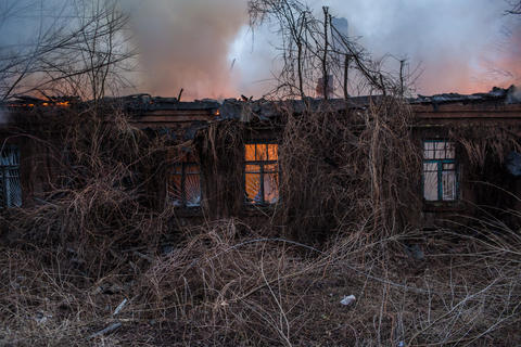 A medical clinic burns after being hit by artillery Feb. 14, 2015, in Artemivsk, Ukraine.