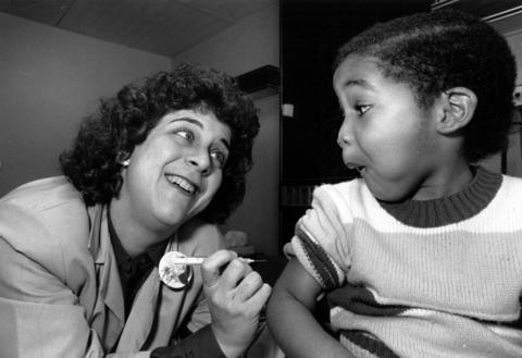 Dr. Janice Silver, a family practitioner at Lutheran General Hospital-Lincoln Park, gets ready to innoculate Jeffrey Blockson, 3, on Feb. 22, 1989.