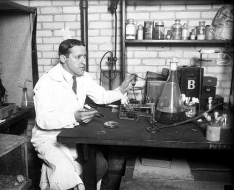 "Dr. Isidore S. Falk, assistant professor of hygiene and bacteriology at the University of Chicago, with his new pneumonia cure apparatus in March 1926. Dr. Falk worked on isolating the influenza virus during the 1928 flu epidemic. By 1929 he had isolated the germ and cautiously stated that there is a ""hopeful prospect"" that an antitoxin for influenza would now be discovered."