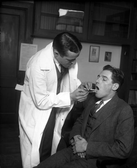Dr. Isidore S. Falk, left, with Alex Finukan, circa February 1928. Dr. Falk was an assistant professor at the University of Chicago in the hygiene and bacteriology department. Dr. Falk was working on isolating the influenza virus and took many swabs from students during the 1928 flu epidemic.