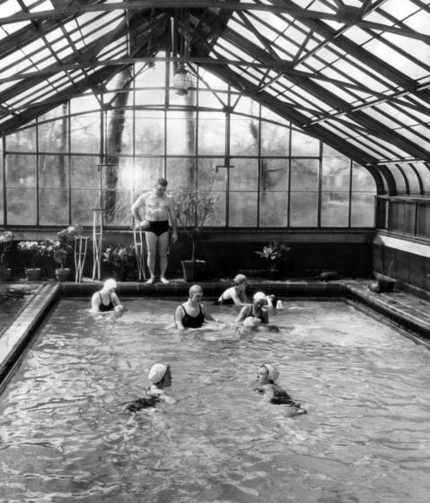 James Carnahan, Red Cross water safety director, watches as Red Cross instructors start a swim class for young polio victims in a pool at the home of Alex T. Spare in Glencoe, Ill., on April 14, 1953. The private pool was used by the Red Cross to aid north suburban polio victims.