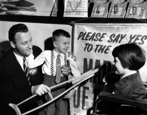 Steven Rice, 6, and Cindy Jane Miller, 6, were picked as the March of Dimes children for the Cook County campaign on Dec. 12, 1960. General campaign chairman Henry Bartholomay, left, greets the children. Both Rice and Miller are polio victims.