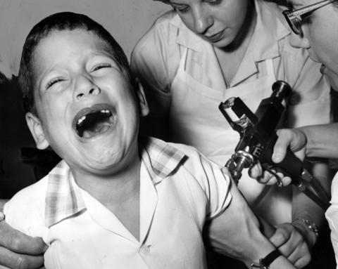 Junior Gil, 7, cries while getting his polio shot in the city board of health mobile unit that gave shots at 22nd St. and Kedzie Ave. in Chicago on July 4, 1962. That neighborhood was where the last case of polio was reported.