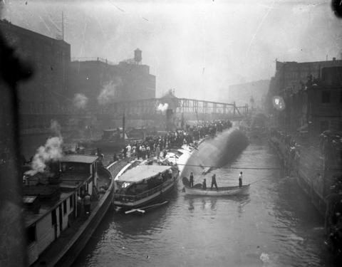 The SS Eastland rests on its side in the Chicago River after slowly rolling over and causing 844 people to drown July 24, 1915.