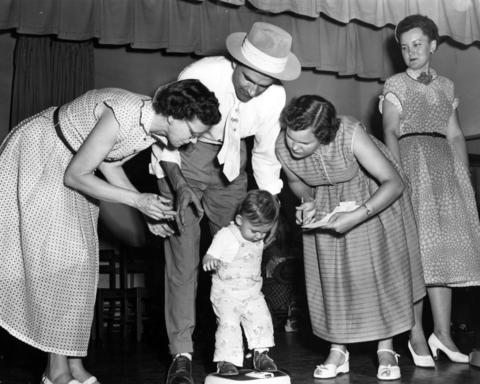 Daniel Nicholis Bednorz, 1, of Warrensburg, Ill., just northwest of Decatur, is weighed to determine the amount of gamma gobulin serum with which he was to be inoculated on July 17, 1953. The polio vaccine was given according to weight.