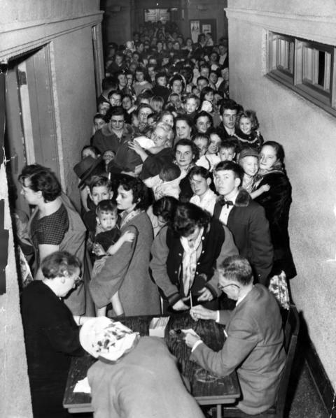 More than 1,200 people waited several hours in line at the Gage Park Field house at 55th and Western avenues for their polio shot on March 11, 1957.