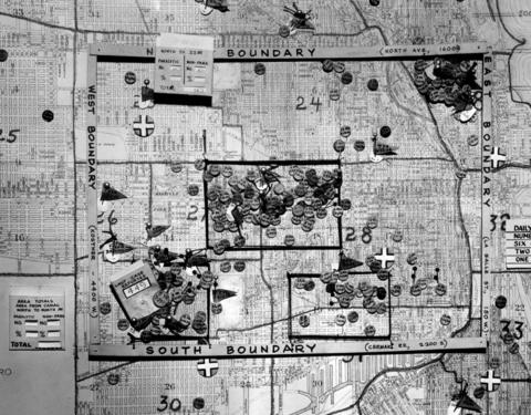 The polio map in Dr. Herman Bundesen's office shows the number of cases in the area, with one of the heaviest areas of incidence bounded by North Avenue, LaSalle Street, Cermak Road and Kostner Avenue. The chart was photographed on July 31, 1956.