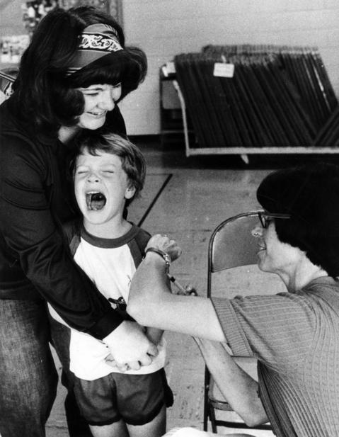 Charlene Goss, of Des Plaines, holds onto her son, Brent, while Dr. Karen Scott gives the 5-year-old a shot on June 15, 1978.