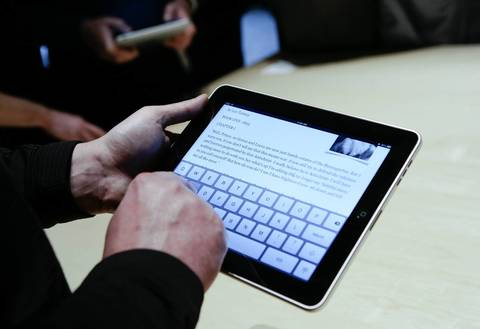 Event guests play with the first-generation Apple iPad during its introduction at the Yerba Buena Center in San Francisco on Jan. 25, 2010.