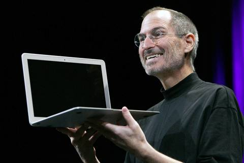 In January 2011, Apple CEO Steve Jobs shows the new MacBook Air during the MacWorld Convention and Expo in San Francisco.
