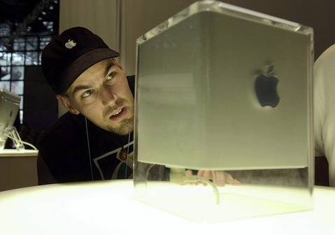 Mark Mineart, of New York, eyes Apple's G4 Cube at the MacWorld Conference and Expo at the Javits Center in New York City in July 2000. Despite Steve Jobs' public affection for it, it still failed.