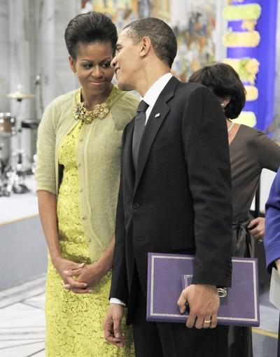 Nobel laureate President Barack Obama speaks with first lady Michelle Obama at the Nobel Peace Prize ceremony at City Hall in Oslo. Pres. Obama accepted the Nobel Peace Prize, uncomfortably acknowledging his role as a leader at war while insisting that conflict can be morally justified.