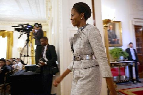 Michelle Obama enters the East Room of the White House where she hosted a classical music event after giving out Coming up Taller Awards to arts groups