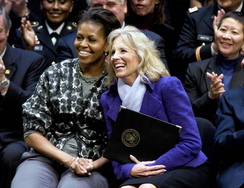"""Michelle Obama and Jill Biden listen as a Alma Powell speaks during the ServiceNation launch of """"MISSION SERVE: Forging A Continuum Of Service"""" at George Washington University."""