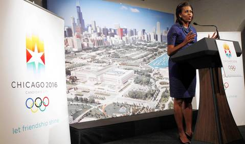 Standing in front of a backdrop of the Chicago skyline, Michelle Obama speaks in support of Chicago hosting the 2016 Summer Olympics, in Copenhagen.