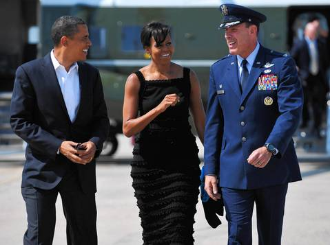 Pres. Barack Obama and First Lady Michelle Obama walk to Air Force One at Andrews Air Force Base in Maryland. Obama and his wife are making a personal visit to New York City.