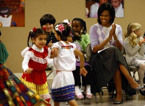 Michelle Obama watches schoolchildren dance at an Hispanic Heritage event at the Latin American Montessori Bilingual (LAMB) Public Charter School in celebration of Cinco de Mayo.