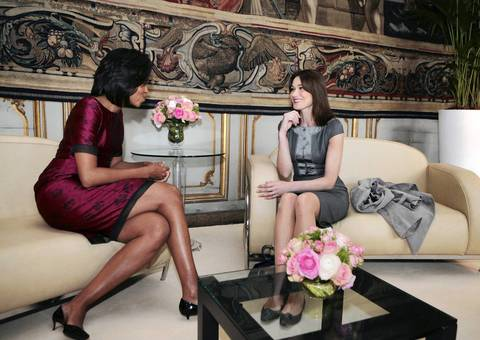 Michelle Obama (L) speaks with France's first lady Carla Bruni-Sarkozy before a lunch at Rohan Palace, as their husbands hold bilateral talks on the first day of the NATO summit in Strasbourg, France.