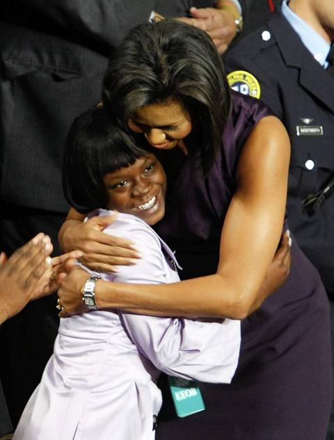 Michelle Obama hugs Ty'Sheoma Bethea, a student from Dillon, S.c. before Pres. Obama addresses a joint session of the legislature in Washington, D.C.