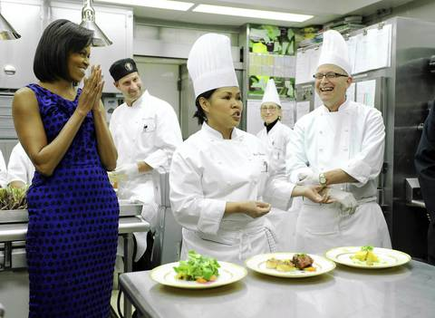 White House Head Chef Cristeta Comerford, center, is joined by Michelle Obama and pastry chef Bill Yosses as she speaks about the Governors' Dinner menu during a preview in the White House kitchen.