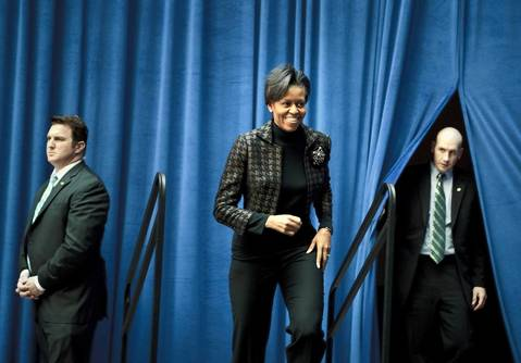 Michelle Obama arrives at the Department of Transportation in Washington, D.C., to speak with employees about working with President Barack Obama's administration.