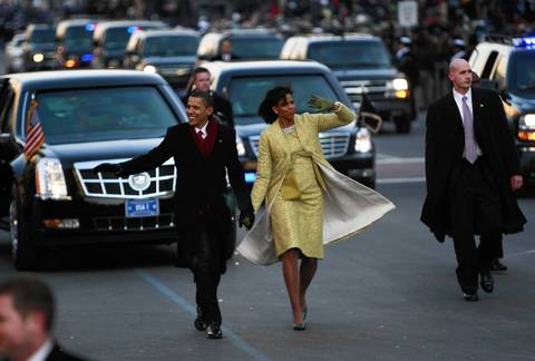 President Barack Obama and first lady Michelle Obama wave to well-wishers during the inaugural parade in Washington D.C.