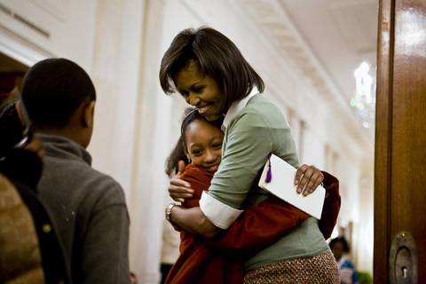 Michelle Obama greets children after celebrating African American History Month event in the East Room of the White House.