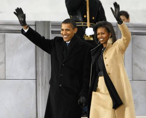 President-elect Barack Obama and Michelle Obama wave to the audience at We Are One: Opening Inaugural Celebration at the Lincoln Memorial in Washington D.C.