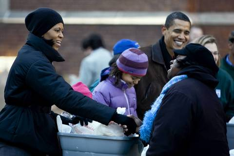 President-elect Barack Obama, wife Michelle and daughters Malia and Sasha, hidden, visit St. Columbanus Catholic Church on the South Side to distribute food for the Greater Chicago Food Depository and to visit with children from St. Columbanus School.