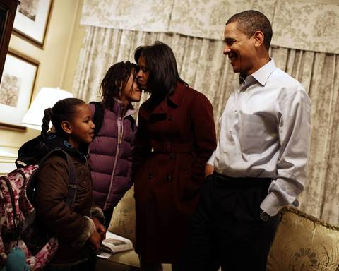 President-elect Barack Obama and his wife Michelle Obama getting their daughters Sasha, 7, and Malia, 10, ready for their first day of school in Washington, Monday, Jan. 5, 2009. The family is staying at the Hay Adams Hotel in Washington.