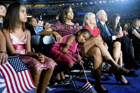 Michelle Obama and daughters Malia, left, and Sasha listen as Sen. Barack Obama delivers his acceptance speech at the INVESCO Field at Mile High Stadium in Denver.