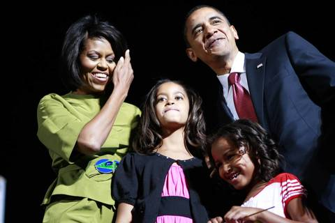 Democratic presidential candidate Sen. Barack Obama arrives with his wife Michelle and daughters Malia, 9, center, and Sasha, 6, at a rally in Des Moines after his victory in the Oregon primary. Obama has won a majority of pledged delegates in the Democratic presidential race.