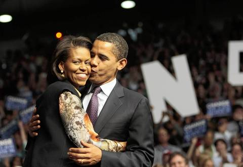 Sen. Barack Obama and wife Michelle smooch at a rally at Roberts Municipal Stadium in Evansville, Ind.