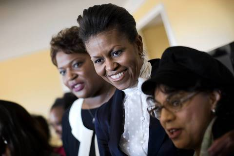 Michelle Obama stands with attendees at a VIP reception before participating at the National Congress of Black Women, Inc. 23rd Awards Brunch in Washington, D.C.