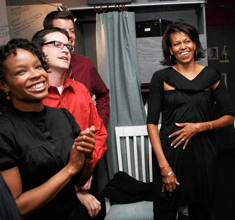 """Michelle Obama, wife of presidential candidate Barack Obama, meets with cast members including Amber Ruffin, left, and Joe Canale, second left, of Second City after watching the show """"Between Barack and a Hard Place"""" at the Second City Theater."""