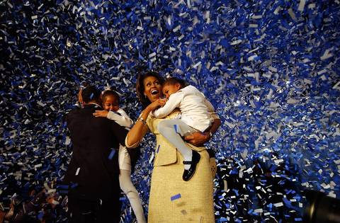 U.S. Senator-elect Barack Obama, with daughter Malia and wife Michelle with daughter Sasha wave to supporters at his victory celebration.