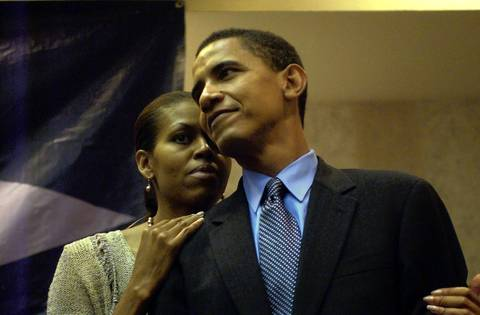 U.S. Senate Barack Obama and his wife Michelle share a moment before the media event at the Matteson Holiday Inn.