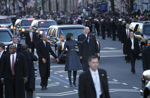 President Barack Obama and first lady Michelle Obama walk a portion of the Inaugural Parade in Washington, D.C. on Jan. 21, 2013.