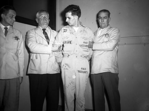 """Sheriff's Deputies Joseph Jacobsen and William Braun, from left, hold onto murderer Richard Carpenter, with help from fellow Deputy Jack Smietana during Carpenter's five-day trial, which began Nov. 7, 1955. According to the Tribune, Carpenter """"refused to clean up or dress up and had to be dragged in handcuffs and leg irons to the courtroom."""" Carpenter confessed to more than 70 robberies in a two-year span, in addition to killing Detective William J. Murphy, 34, and seriously wounding Officer Clarence Kerr, 26, on Aug. 17, 1955. Carpenter, who was often uncooperative in the courtroom and jail, was found guilty and sentenced to die by the electric chair. He was executed on Dec. 19, 1958."""