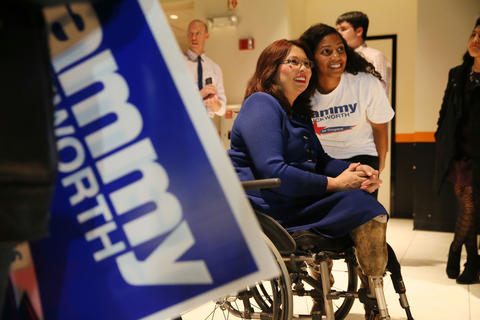 U.S. Rep. Tammy Duckworth poses with campaign workers after her election victory speech at Boomers Stadium in Schaumburg on Nov. 4, 2014.
