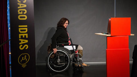 U.S. Rep. Tammy Duckworth heads onstage to speak at Chicago Ideas Week at Morningstar in Chicago on Oct. 13, 2014.